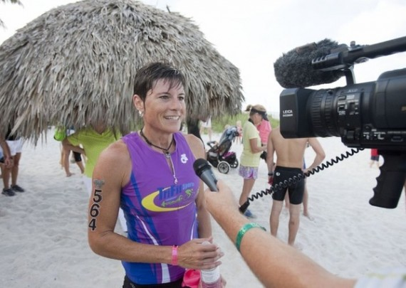 Special to the Daily News/Jason Easterly Heather Butcher of North Port is interviewed after winning the women's leg of the 26th Annual Fitness Challenge Triathlon held at the Naples Beach Hotel and Golf Club on Sunday morning. Participants in the event ran 3.1 miles, biked 9.3 mile and swam 1/4 mile in the Gulf of Mexico.